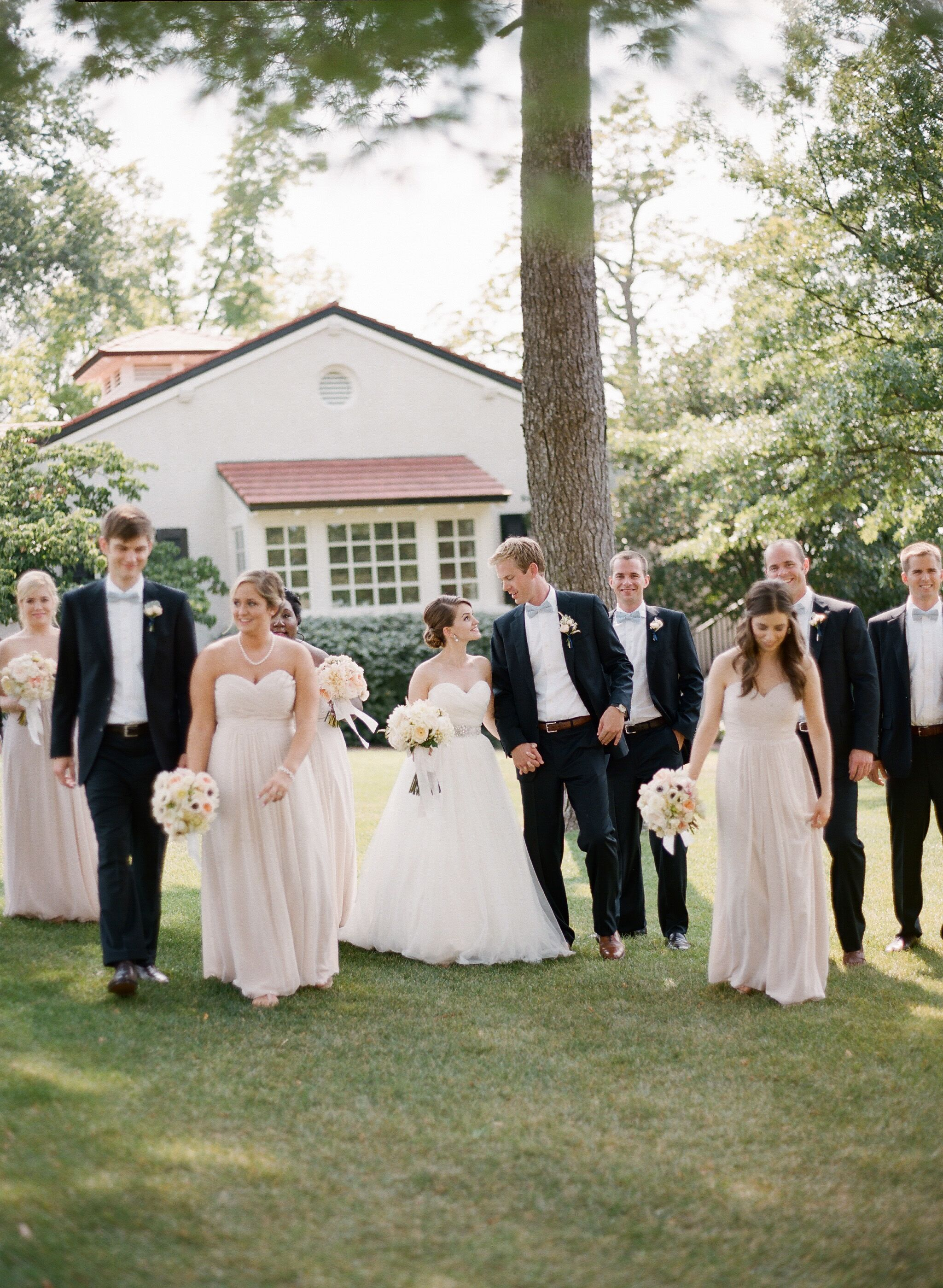 Formal Black, White And Champagne Wedding Party Attire