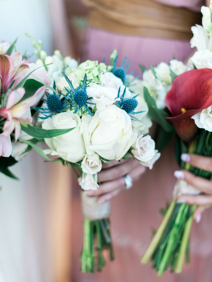Ashley and Brad purchased roses, hydrangeas and gerbera daisies from a local nursery and created their own bouquets before the wedding to save money. Each bouquet was different, some with bright pops of blue or pink, and each was made with love and care by a member of the wedding party.
