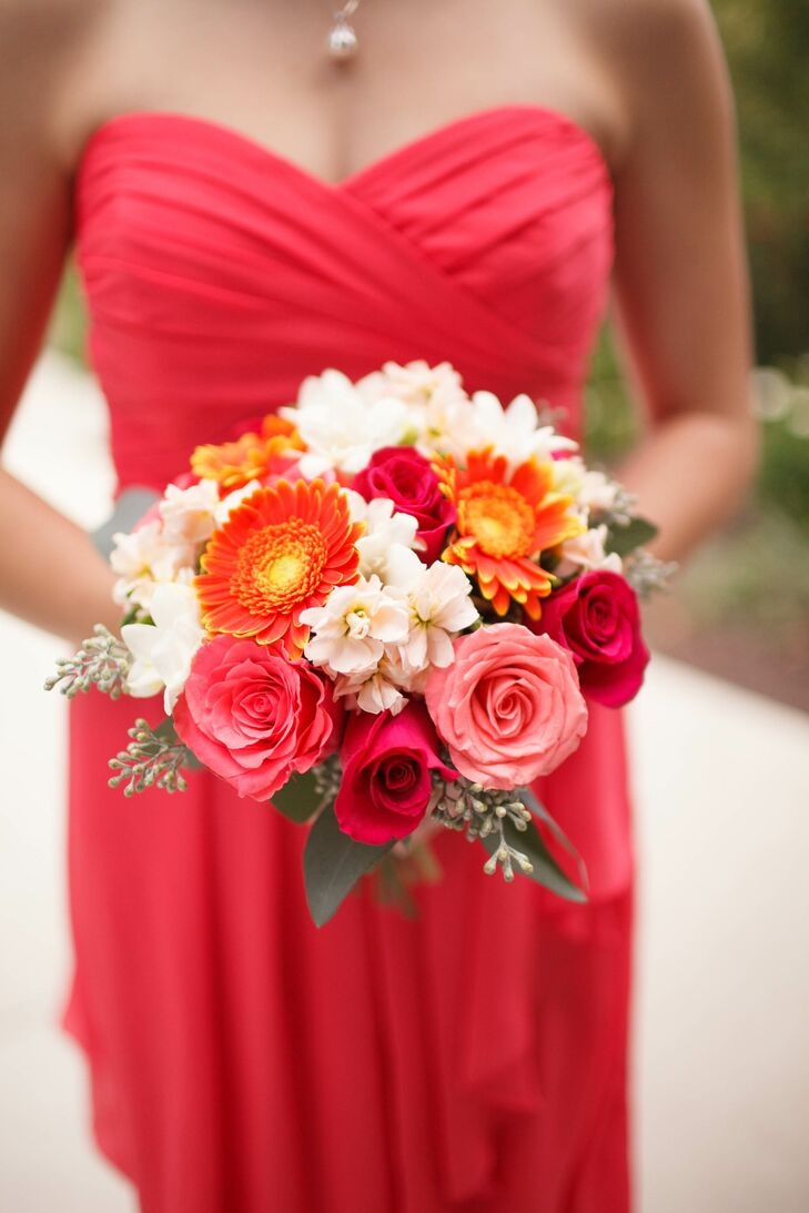 Bridesmaid Wearing Coral Dress With Bouquet