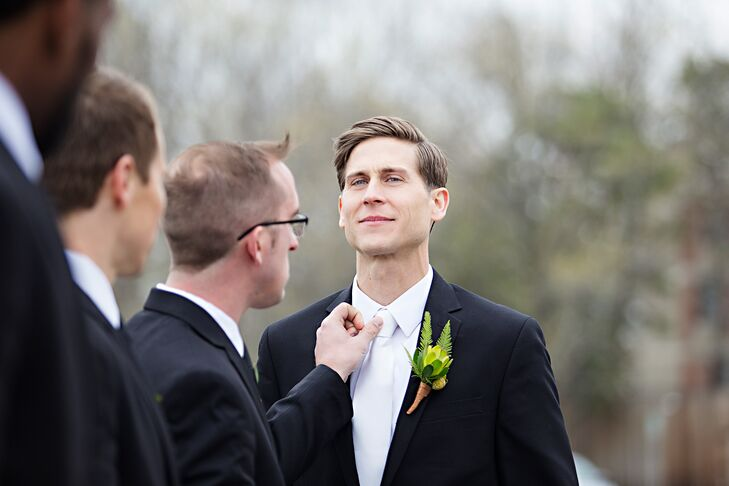Adam went for a modern yet classic look with a black slim suit, white shirt and tie, and black shoes. The groomsmen wore black ties instead of white.
