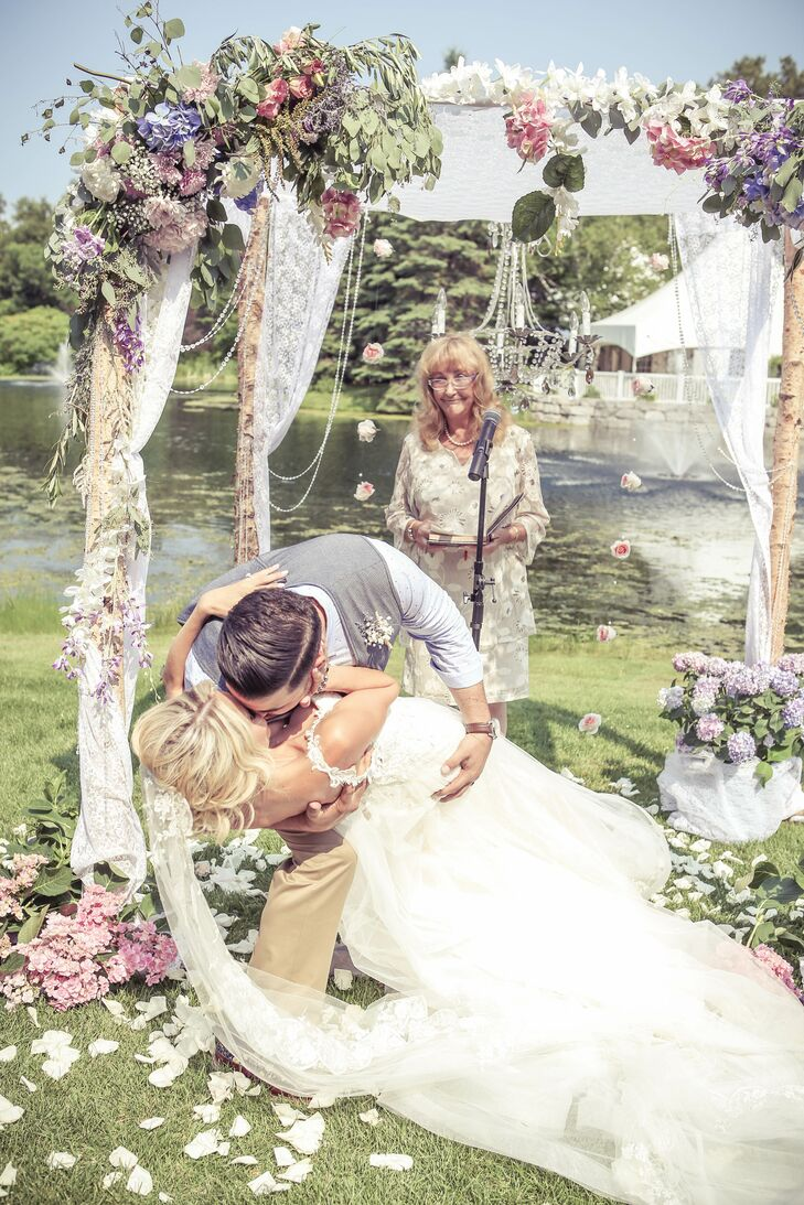 The couple exchanged vows underneath a custom-made birch-branch chuppah covered in pastel flowers.