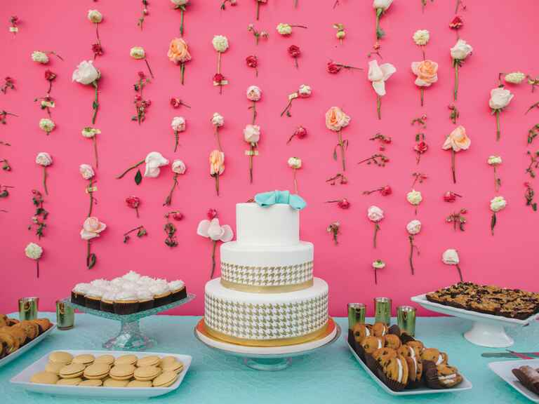 Hot pink cake display with taped flower decor
