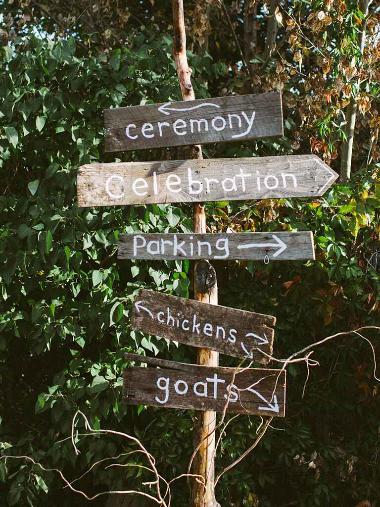 Rustic wedding sign with the ceremony, reception and parking
