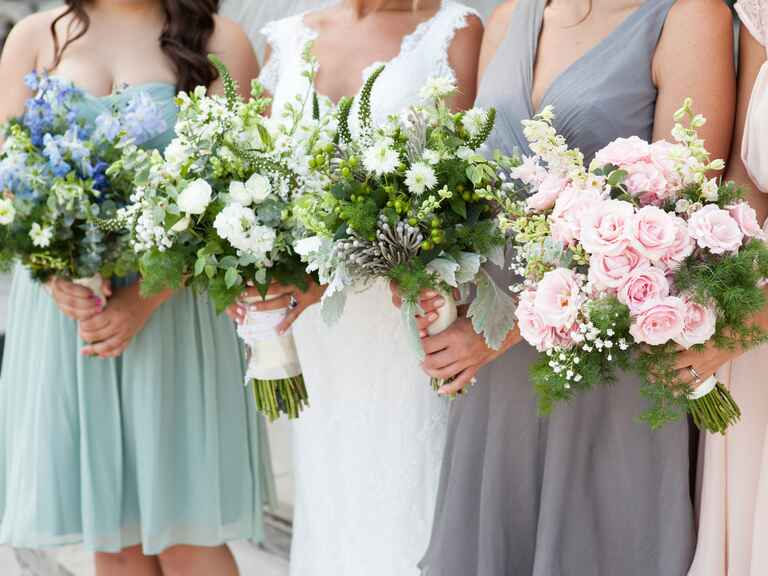 Mismatched bridesmaid bouquets in different colors