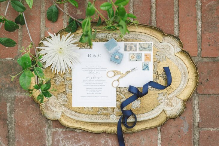 The wedding invitations had a mixed style of simple yet elegant! White stationery had accents of gray text decorating its pages, with no additional designs to take away from the classic look.