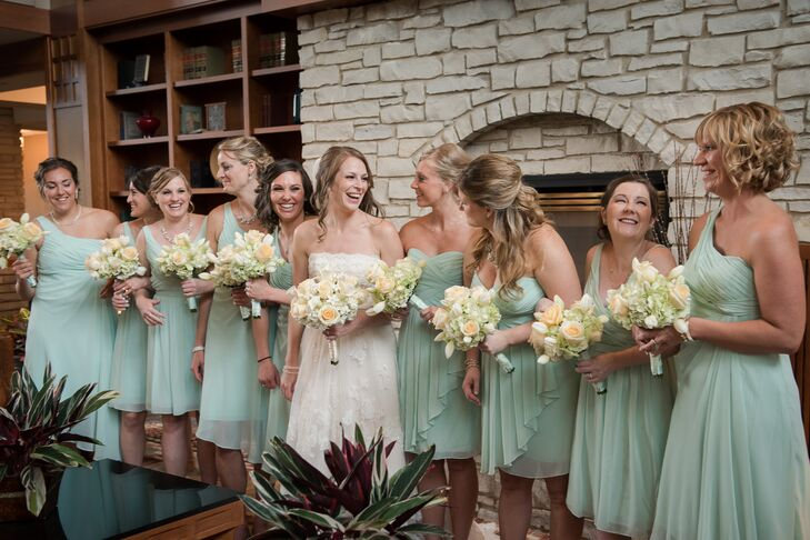 The bridesmaids wore mint green dresses from David's Bridal. Kim choose three styles and let her bridesmaids choose the style they liked the most.