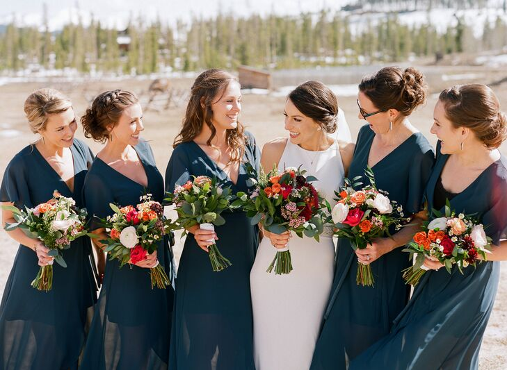 "The bridesmaids wore jade-colored maxi dresses for the ultimate in comfort. ""Two of the five bridesmaids were breastfeeding, so choosing a dress with the ability to wear a normal bra was essential,"" Liz says."
