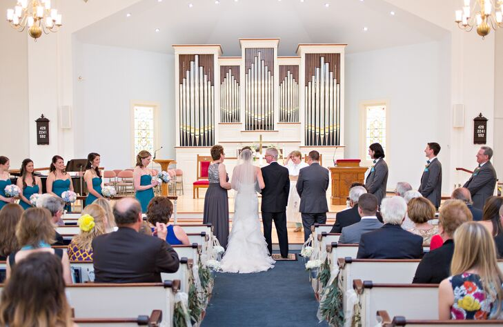 "The First United Methodist Church of Chatham in Chatham, Massachusetts, was a must for Lindsey and Keith's ceremony. ""After attending a service, meeting the congregation and speaking with the pastor we felt very at home,"" Lindsey says. ""The beautiful clock tower, stained glass windows and wooden pews were the exact Cape touch we wanted for our ceremony."""