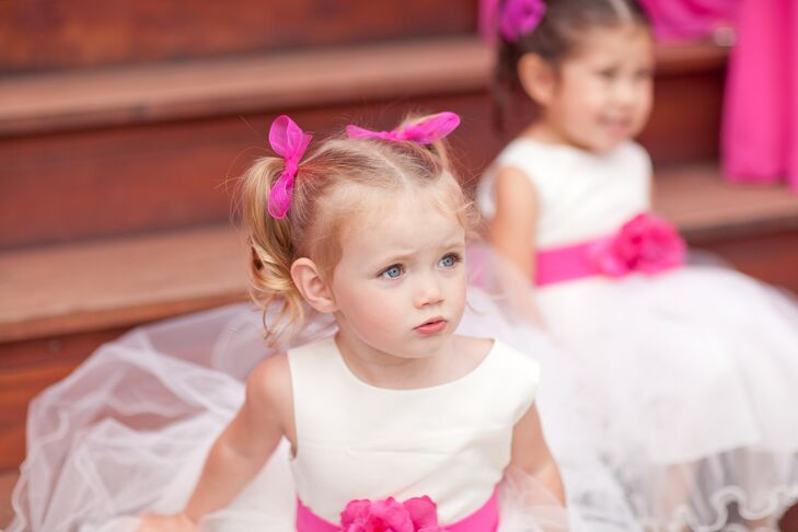 The flower girls wore white tulle dresses with pink bows in their hair and a pink peony belt.