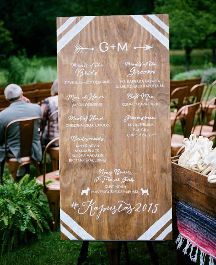 Instead of paper programs, Gina and Mike opted for something more fitting for their bohemian style: listing each member of their wedding party in white on an wooden sign. The note also included their hashtag for anyone who wanted to post photos on social media.