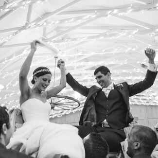 Jewish wedding hora chair dance