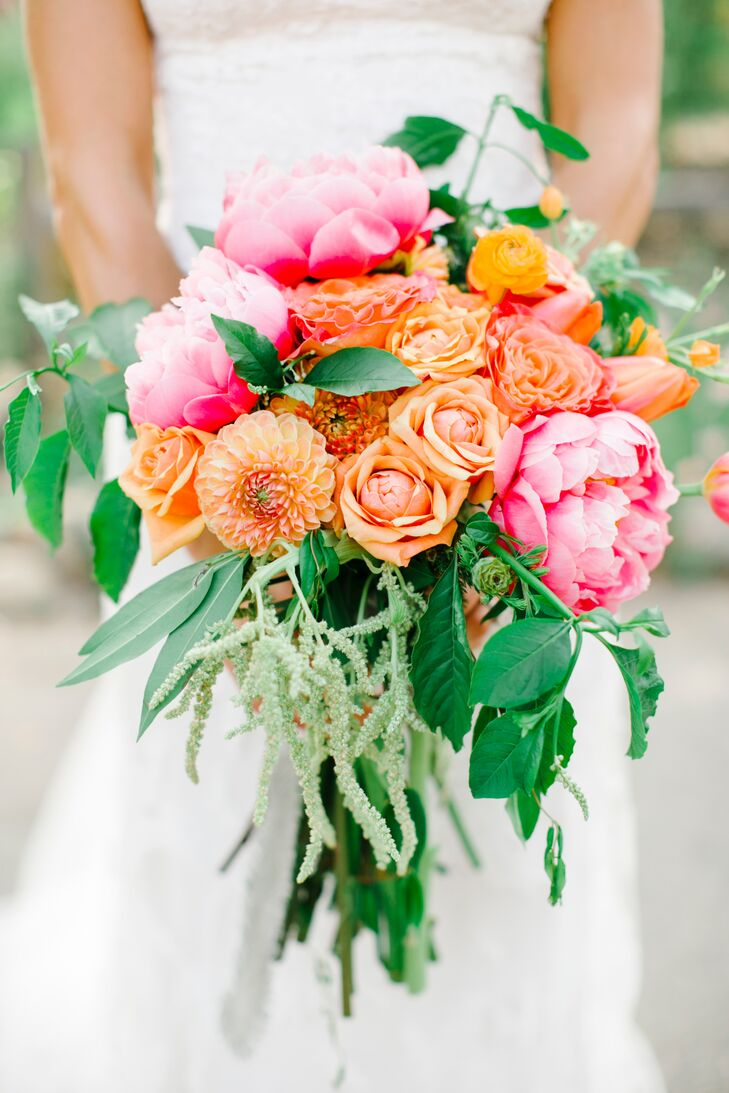 Orange roses and dahlias mixed with pink peonies created a lovely bouquet for the occasion. Greens and leaves added to the flower arrangement made the bouquet overflow with beauty.