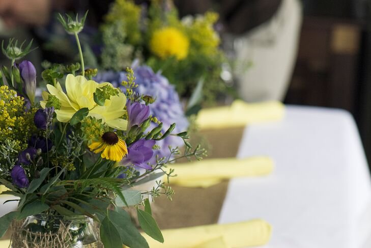 Yellow and purple flower arrangements and burlap table runners mightylinksfo