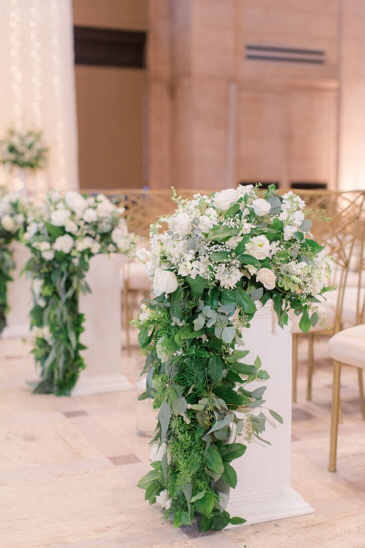 Cascading Greenery And White Flower Aisle Arrangements