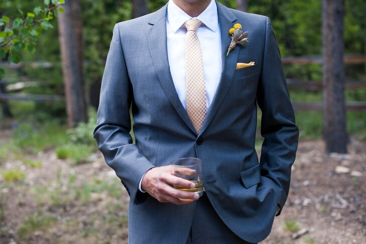 Phil wore a Hugo Boss Red Label Suit with a yellow pocket square to match the wedding colors.