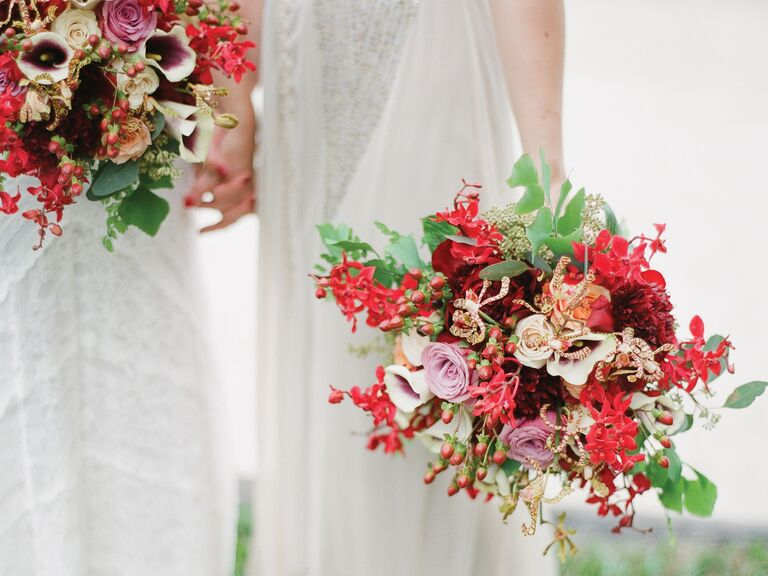 Same-sex wedding holding bouquet