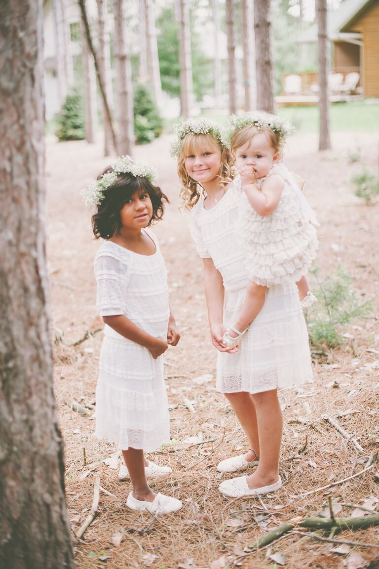 Flower girls before woodland wedding