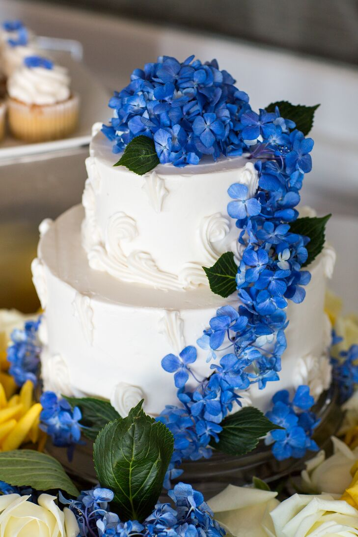 2 tier wedding cake with blue flowers two tier wedding cake with cascading blue flowers 10180