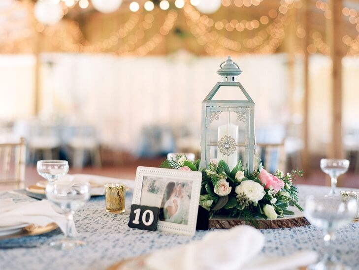 Lanterns, flowers and wood slices decorated some of the tables. The couple used their engagement photos as table numbers.