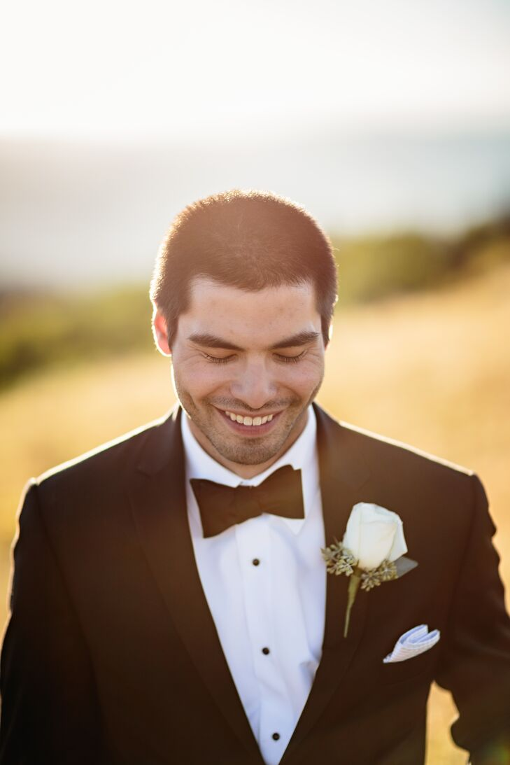 The groom wore a single white rose on his lapel.