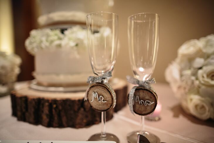The newlyweds champagne flutes were marked with wood and wire Mr and Mrs signs, which were tied to the glasses with sparkly silver ribbon.