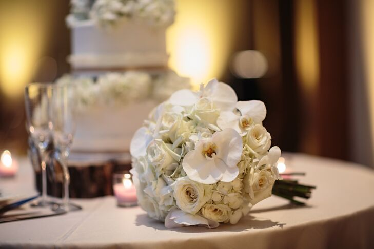 The bride carried white orchids, roses and hydrangea.