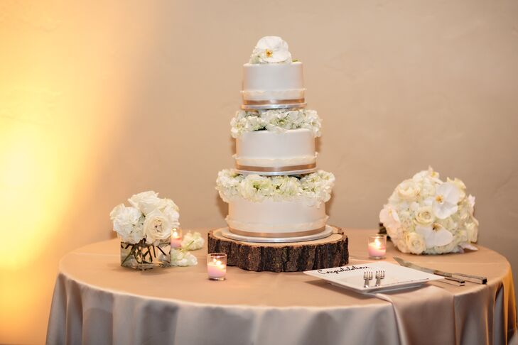 The couple enjoyed a three-tier white cake decorated with fresh, white hydrangea and orchids.
