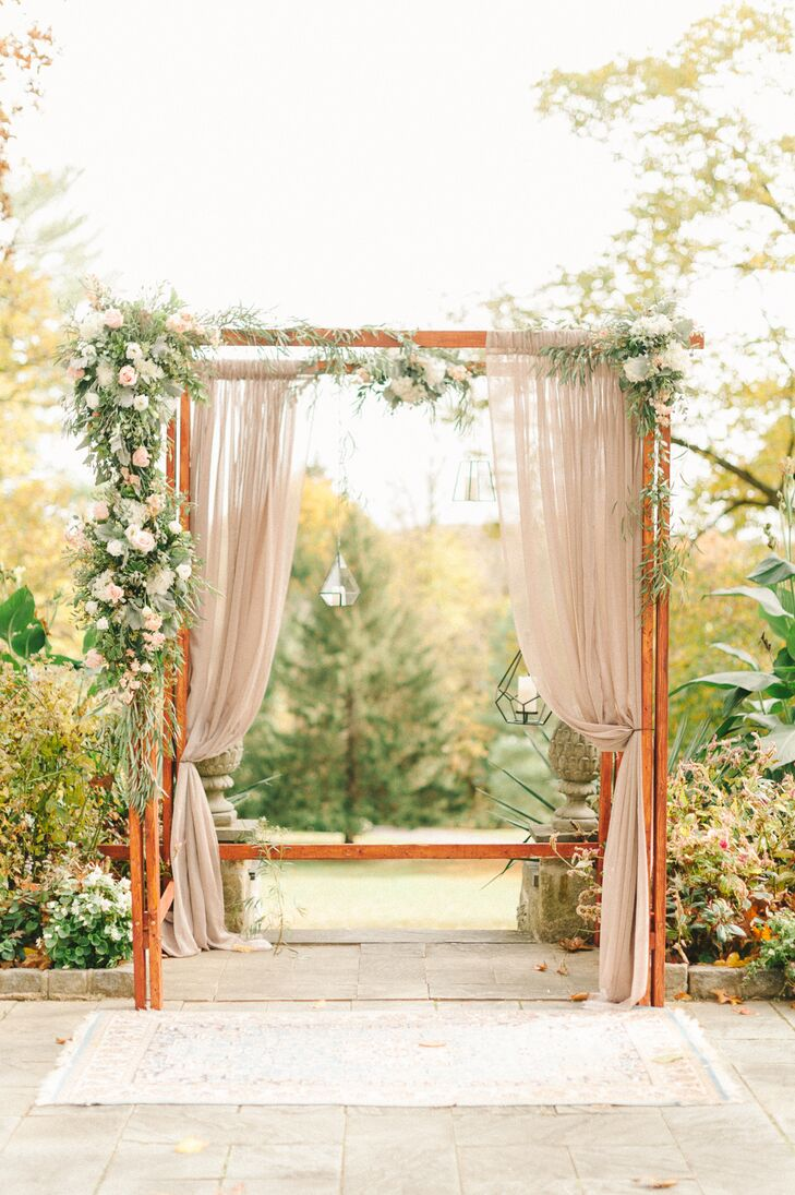Geometric Lantern and Blush Organza Decorated Wedding Arch