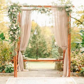 Geometric Lantern And Blush Organza Decorated Wedding Arch