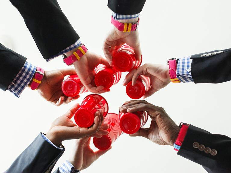 Groomsmen toast with red Solo cups
