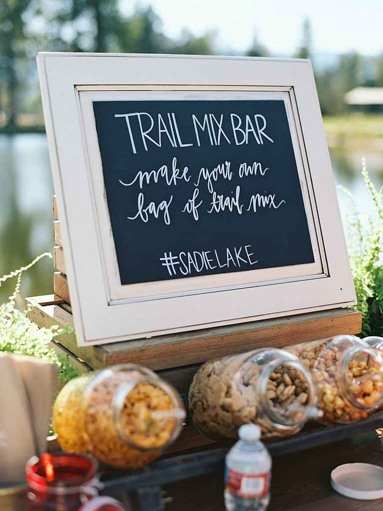 Reception sign for a rustic camp wedding food station