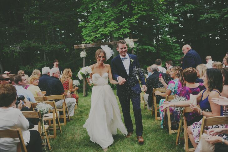 """Our wedding took place in front of the woods,"" Brittany says. ""Our friends sang Mumford & Sons for the wedding party processional and I walked down the aisle to a ukulele version of 'Can't Help Falling in Love.'"""