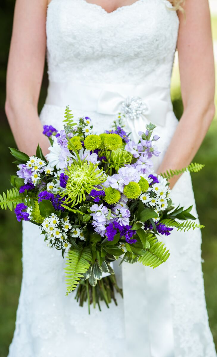 Jaime carried a loose bouquet of purple, green and white chrysanthemums, veronica and aster.