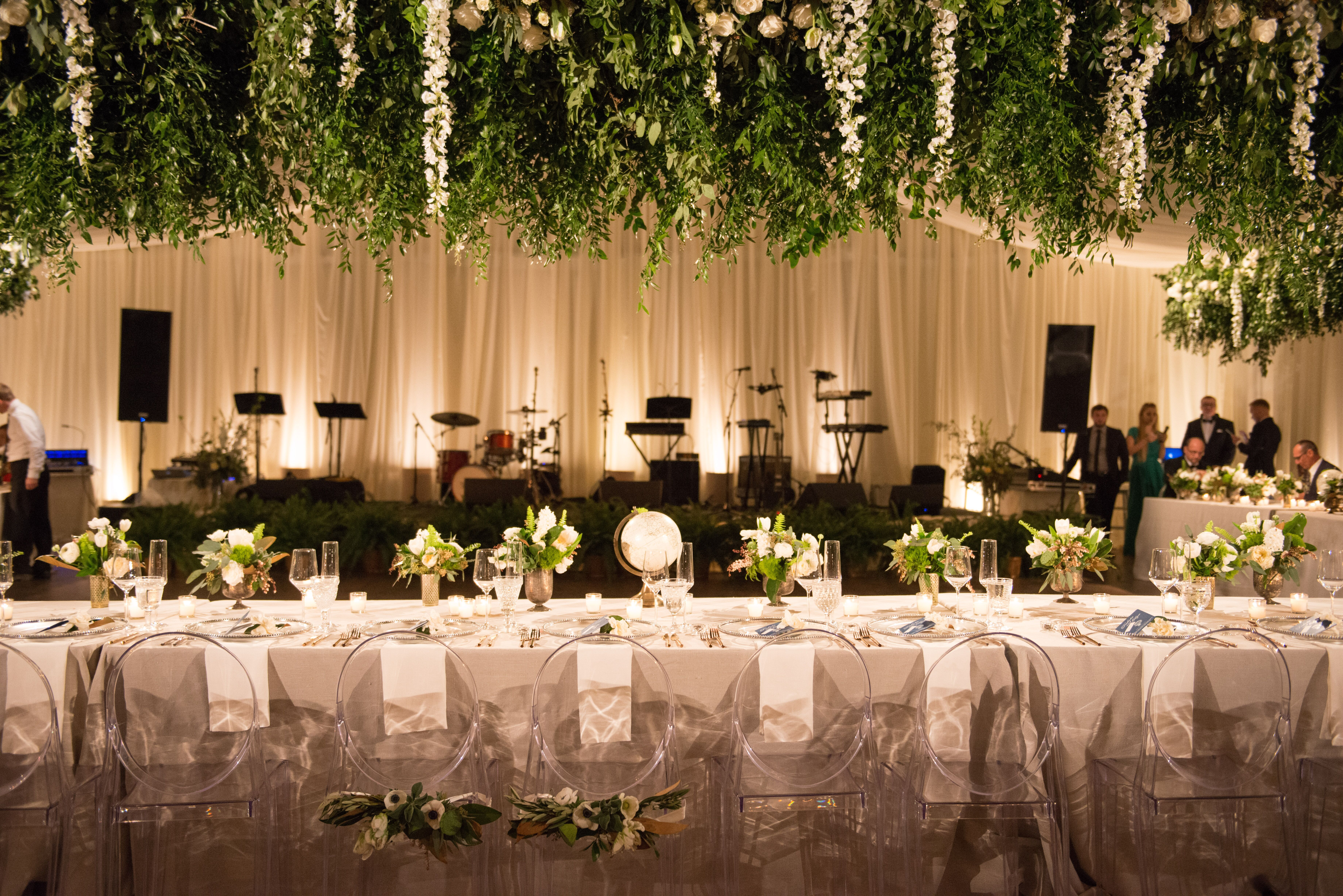 Greenery And Flowers Hanging From Ceiling
