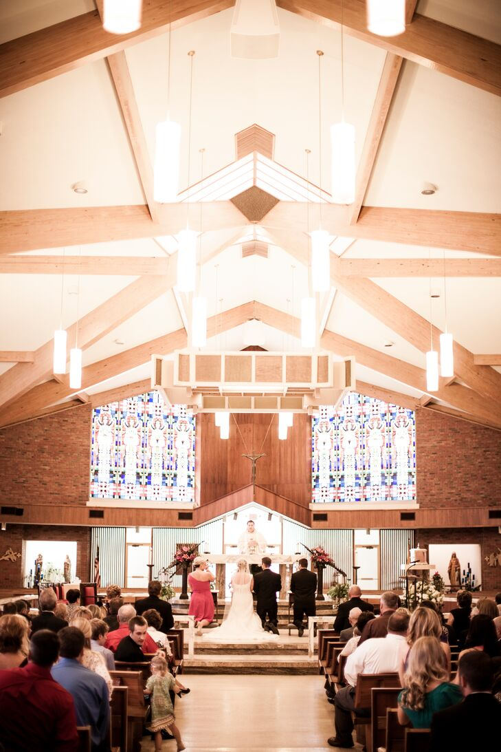 Liza and Nate exchanged vows in a traditional Catholic ceremony at St. Ann Catholic Church in Kansas. They loved the vaulted ceilings, exposed brick and stained glass.