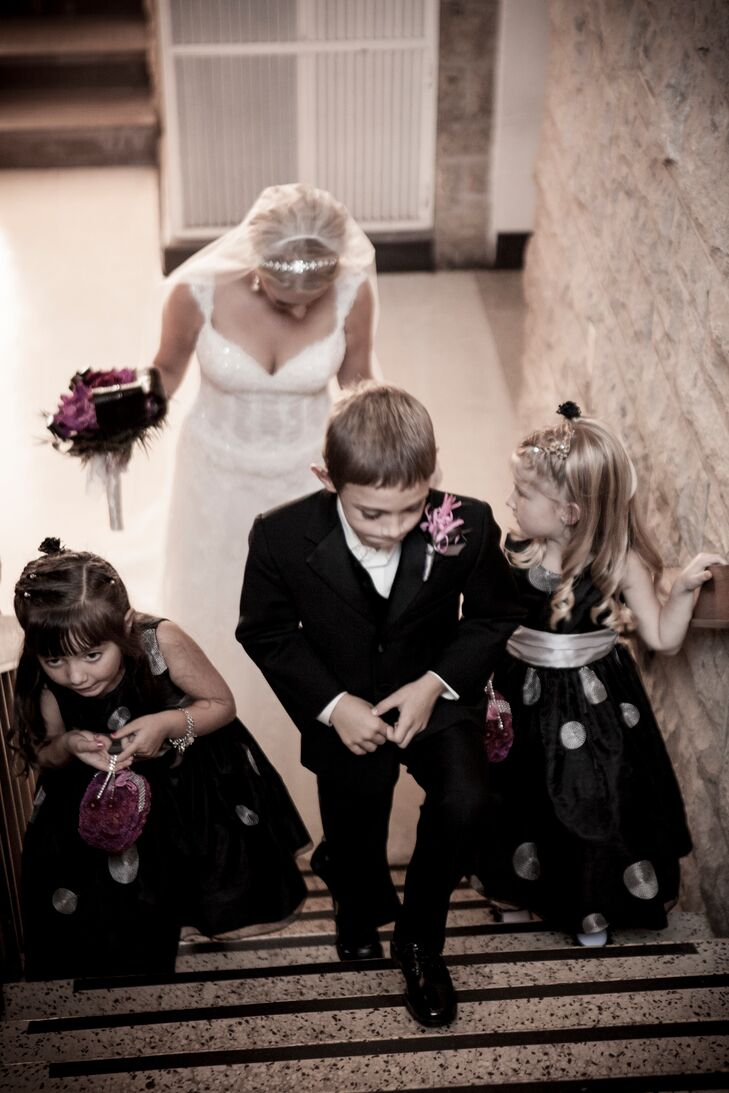 The flower girls wore black dresses with silver polka dots.