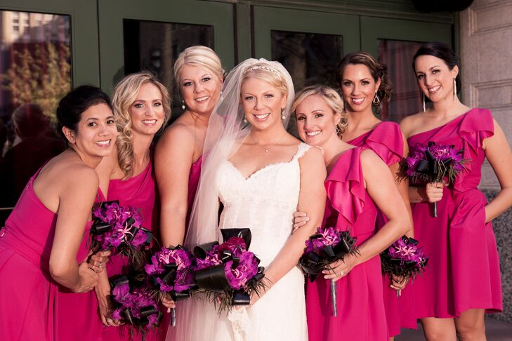 The bridesmaids wore pink one-shoulder Lela Rose dresses.