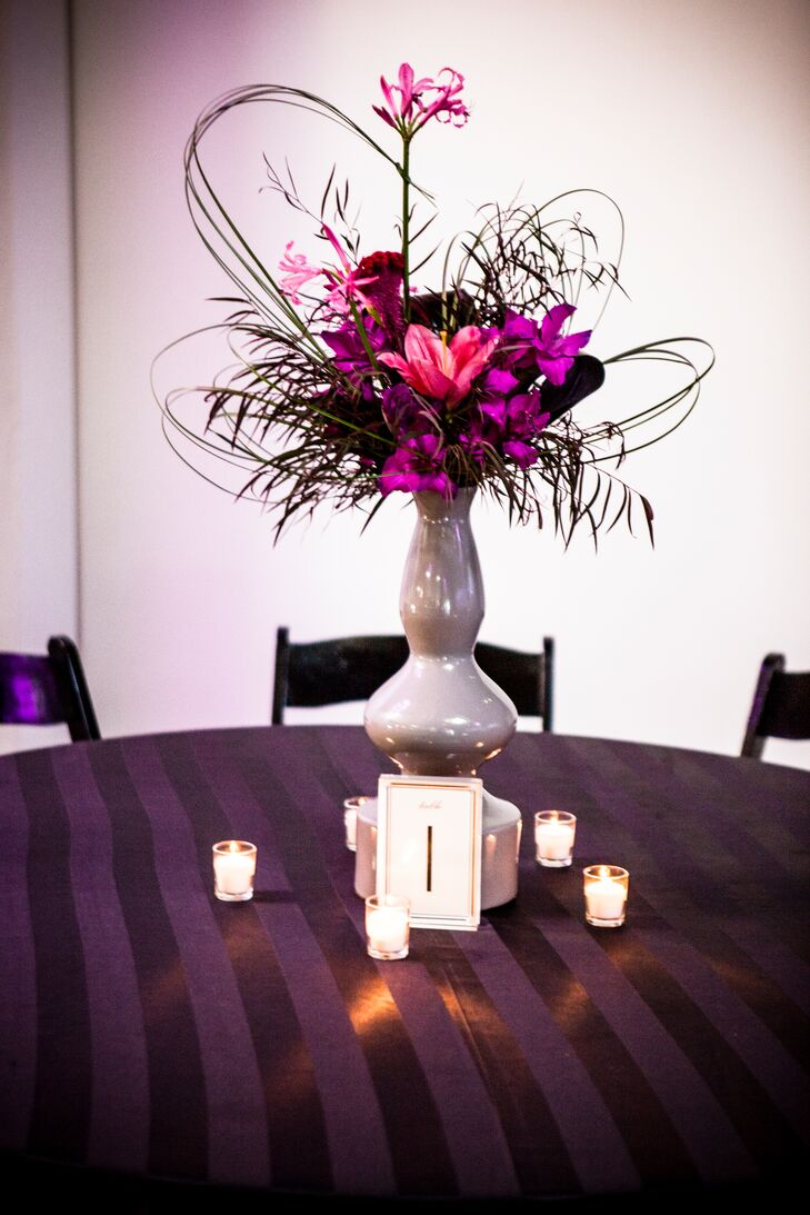 The centerpieces included purple lilies and gloriosa lilies.