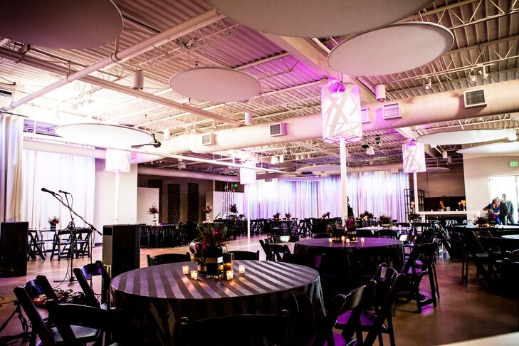 Liza and Nate decorated their simple reception with black linens, small centerpieces and purple uplighting.