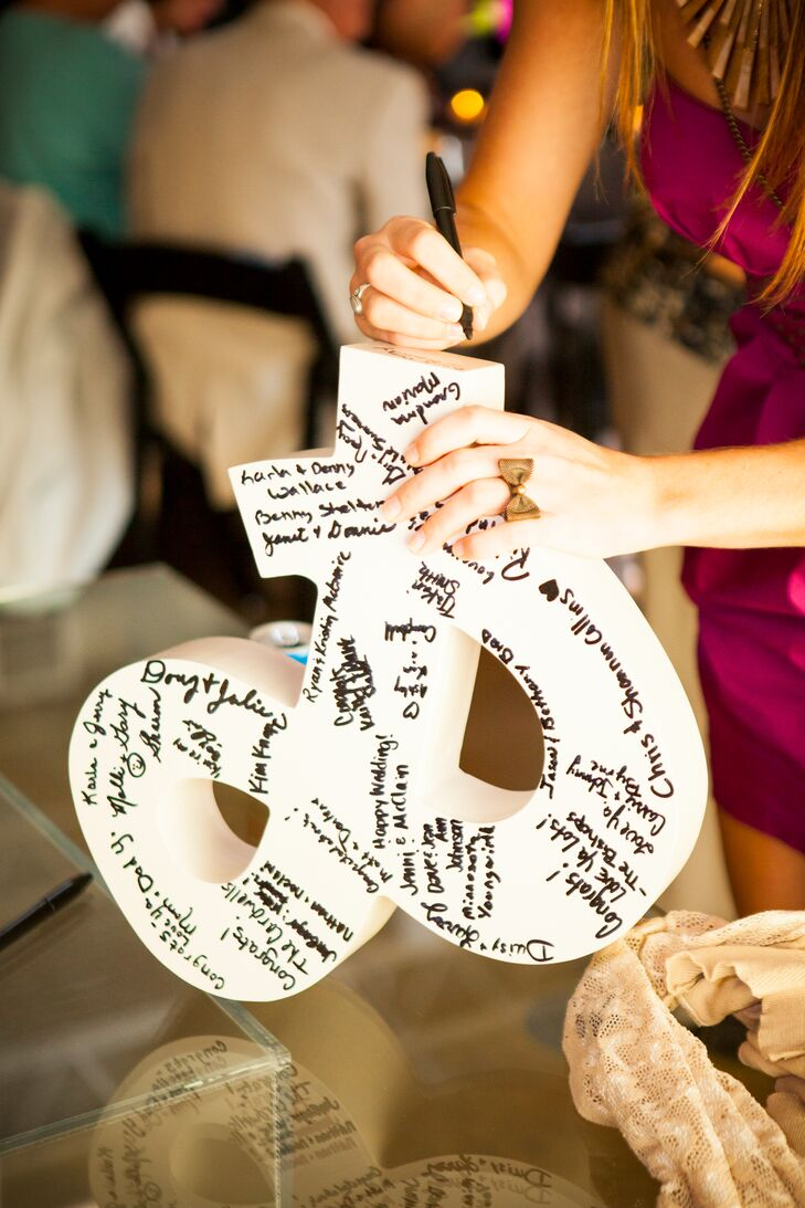 Guests signed a wooden ampersand for the newlyweds.