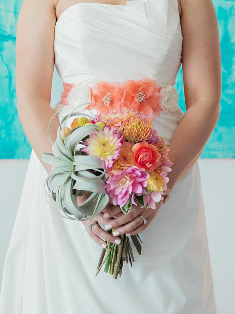Unique wedding bouquet idea with a statement airplant accent