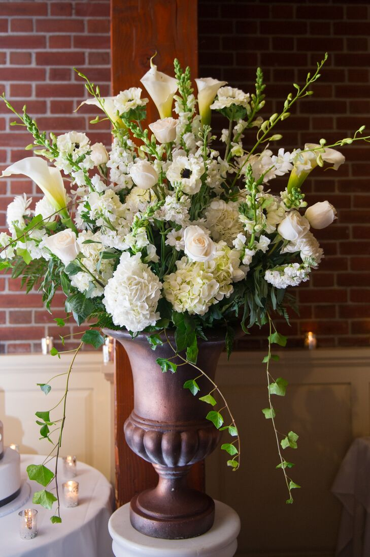 flower arrangement with calla lilies and anemones