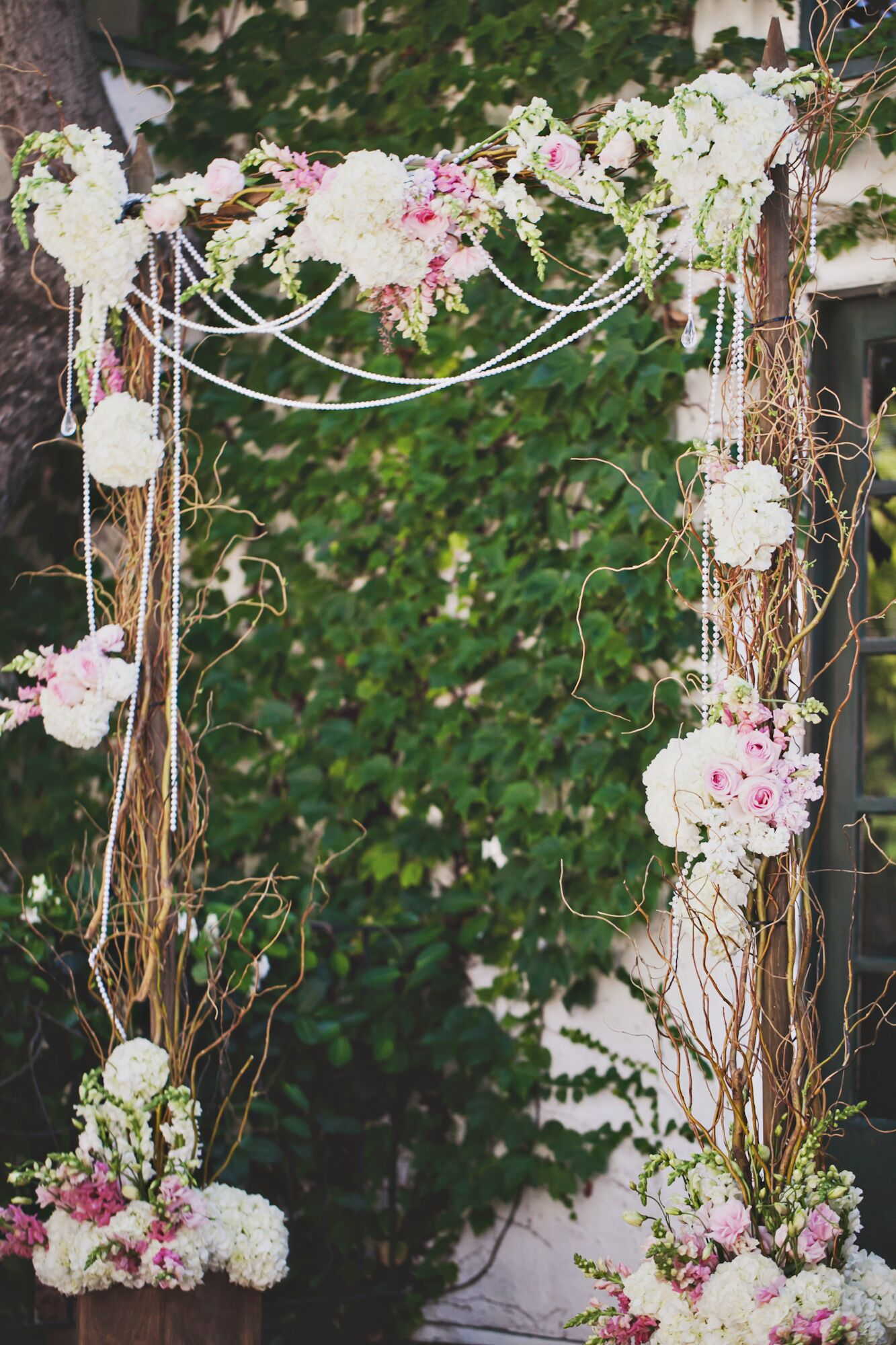romantic pearl and blush floral wedding arch