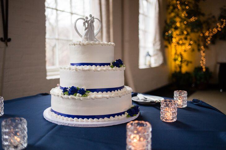 White Wedding Cake With Royal Blue Ribbon