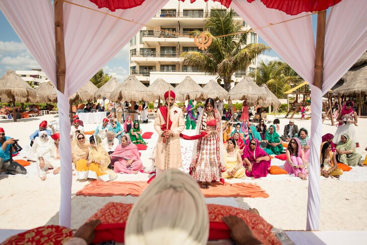 Bride And Groom At Traditional Sikh Ceremony On Beach