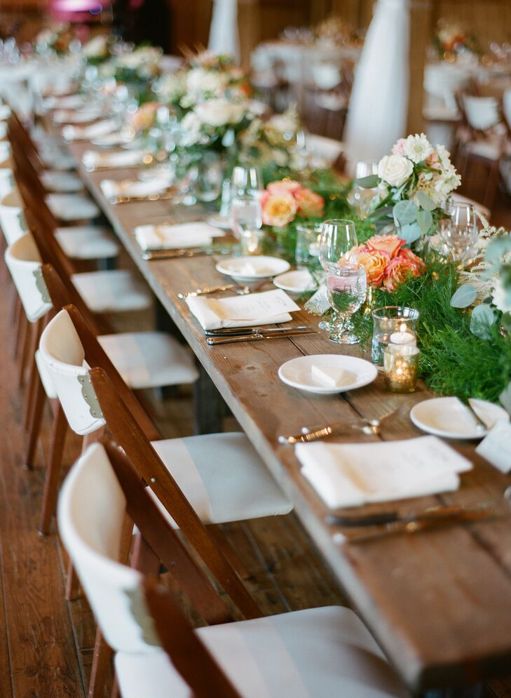 A 22 foot garland of plumosa, sprengerii and tree fern ran the length of the long wooden head table.