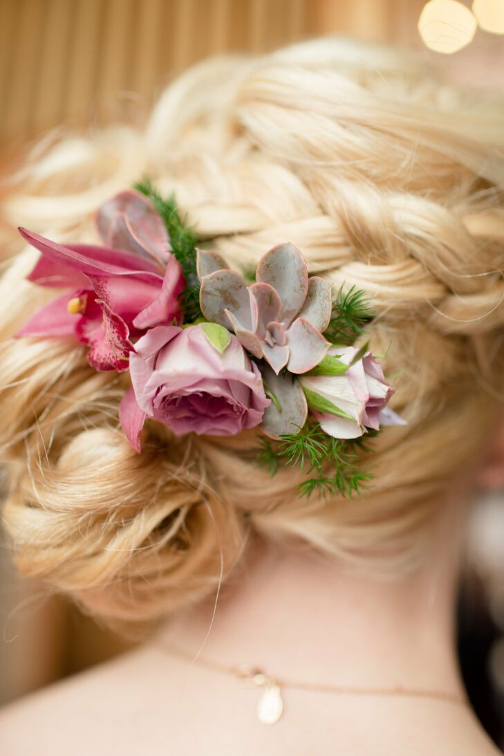 Katie wore a purple rose and green succulent fresh flower hairpiece.