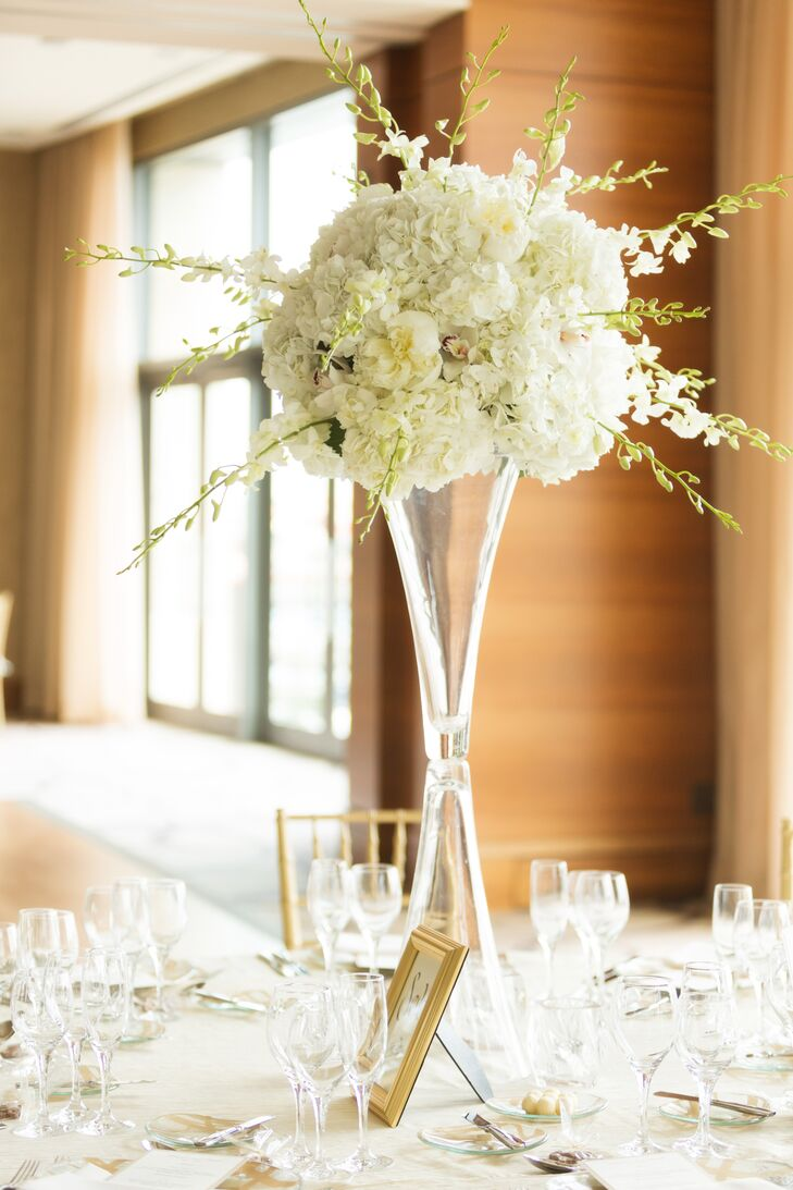 White orchid hydrangea and peonie centerpieces in tall