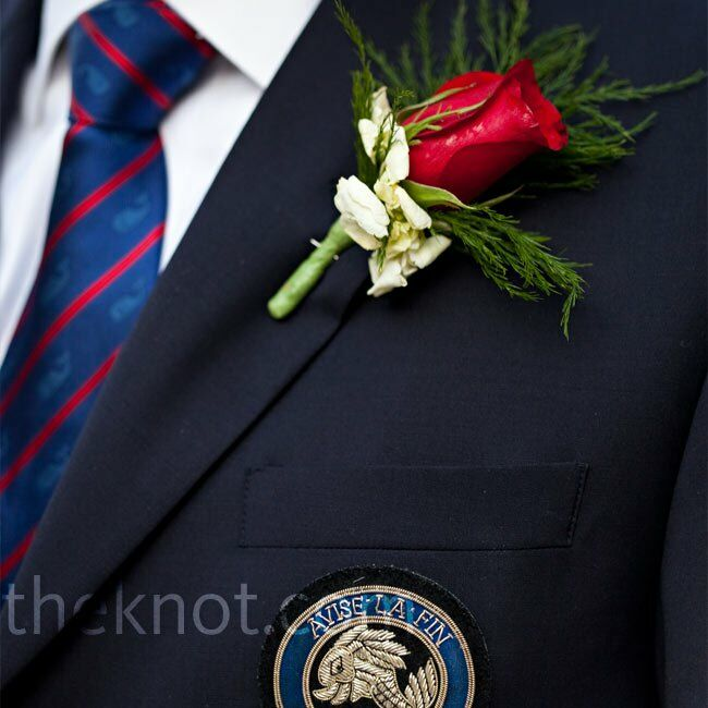 Mark matched his bride's bouquet with a single red rose on his lapel.