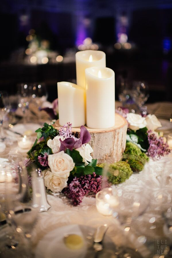Centerpieces with candles on wood slabs